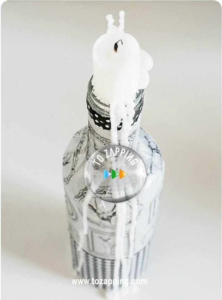 Botellas convertido en porta velas